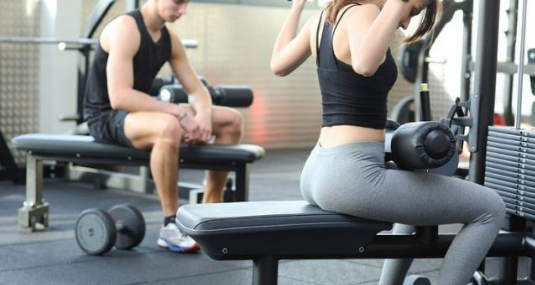 How should the fitness equipment of the small gym be allocated?